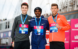 Mo Farah, (centre) the winner of the vitality big half alongside Callum Hawkins, (left) and Jonny Mellor as they pose for a picture for the 1, 2, 3 in the UK Championships during the Vitality Big Half in London City Centre.
