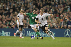 12.10.2012, Aviva Stadium, Dublin, IRL, FIFA WM Qualifikation, Irland vs Deutschland, im Bild v.l. Shane Long (Irland), Toni Kroos (Deutschland/FC Bayern Muenchen), Aktion // during FIFA World Cup Qualifier Match between Ireland and Germany at the Aviva Stadium, Dublin, Ireland on 2012/10/12. EXPA Pictures © 2012, PhotoCredit: EXPA/ Eibner/ Oliver Vogler..***** ATTENTION - OUT OF GER *****