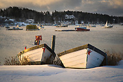 Two boats are pulled ashore with gear for the winter in Mackerel Cove on Bailey Island.