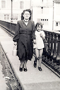 mother walking with daughter France 1950