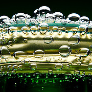 Perrier bubbles emerging from a cap Ray Massey is an established, award winning, UK professional  photographer, shooting creative advertising and editorial images from his stunning studio in a converted church in Camden Town, London NW1. Ray Massey specialises in drinks and liquids, still life and hands, product, gymnastics, special effects (sfx) and location photography. He is particularly known for dynamic high speed action shots of pours, bubbles, splashes and explosions in beers, champagnes, sodas, cocktails and beverages of all descriptions, as well as perfumes, paint, ink, water – even ice! Ray Massey works throughout the world with advertising agencies, designers, design groups, PR companies and directly with clients. He regularly manages the entire creative process, including post-production composition, manipulation and retouching, working with his team of retouchers to produce final images ready for publication.