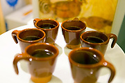 The traditional cups used to serve a queimada punch from a queimada set. Rooted in Celtic tradition, a queimada is believed to ward off evil spirits. Santiago de Compostela, Galicia, Northern Spain.