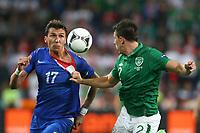 Football - European Championships 2012 - Republic of Ireland v Croatia<br /> Mario Mandzukic of Croatia and Sean St Ledger of Ireland in action at the Municipal Stadium, Poznan