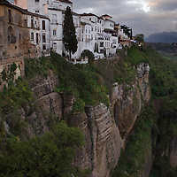 At break of day: View from the puente nuevo (the ' new bridge' , finished 1793) on the line of houses that live on the cliff of El Tajo canyon, 390ft above the GuadalevÌn River on it's floor.
