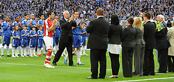 LONDON, ENGLAND - Saturday, April 18, 2009: The Football Association Chairman Lord David Triesman, Arsenal's captain Cesc Fabregas and Chelsea's captain captain John Terry applaud the Hillsborough Family Support Group after presenting flowers in memory of the 96 Liverpool supporters who died at an FA Cup Semi-Final 20 years ago in 1989, before the FA Cup Semi-Final match at Wembley. (Photo by Robin Parker/Pool/Propaganda)
