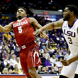 Jan 14, 2017; Baton Rouge, LA, USA; Alabama Crimson Tide guard Avery Johnson Jr. (5) shoots over LSU Tigers center Elbert Robinson III (3) during the first half of a game at the Pete Maravich Assembly Center. Mandatory Credit: Derick E. Hingle-USA TODAY Sports