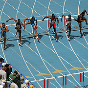 All in step, hurdlers look like the Rockettes as they clear the first hurdle in their race at the Drake Relays.  photo by david petersonDes Moines, Ia., April 25, 2009 - DRAKE RELAYS PHOTOGRAPH BY DAVID PETERSON -