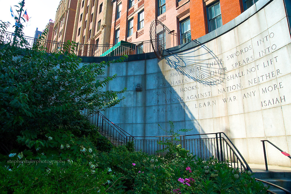 A June oasis opposite the United Nations on 1st Avenue  inside Turtle Bay neighborhood is the Isaiah Wall, bordering the Northern end of Ralph Bunche Park with biblical inscription from book of Isaiah.