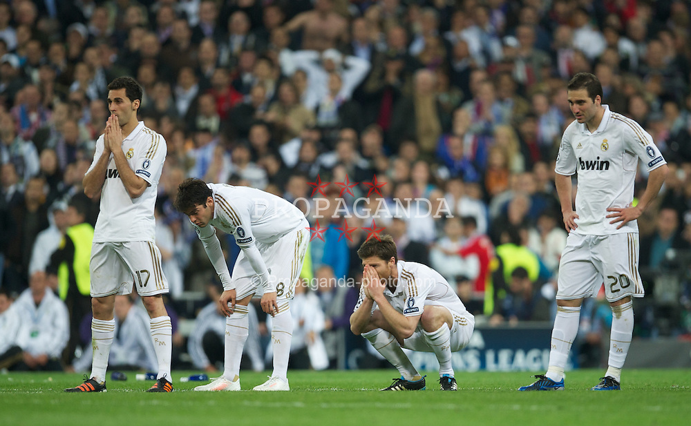 MADRID, SPAIN - Wednesday, April 25, 2012: Real Madrid's Alvaro Arbeloa, Kaka, Xabi Alonso and Gonzalo Higuain look dejected after losing on penalties to Bayern Munchen during the UEFA Champions League Semi-Final 2nd Leg match at the Estadio Santiago Bernabeu. (Pic by David Rawcliffe/Propaganda)