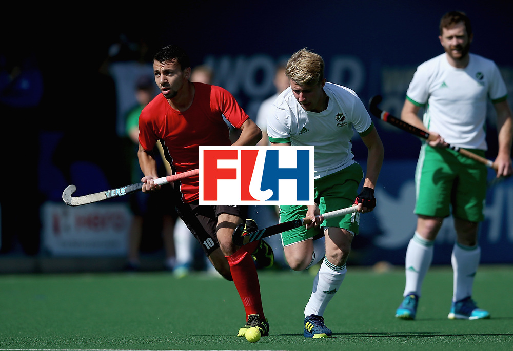 JOHANNESBURG, SOUTH AFRICA - JULY 13: Neal Glassey of Ireland and Ashraf Said of Egypt battle for possession during day 3 of the FIH Hockey World League Semi Finals Pool B match between Ireland and Egypt at Wits University on July 13, 2017 in Johannesburg, South Africa. (Photo by Jan Kruger/Getty Images for FIH)