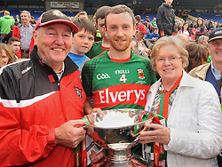 Mayo captain Keith Higgins celebrates with his parents Pete and Kay Higgins with the Nestor Cup in Hyde Park on sunday.<br />