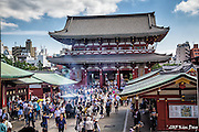 Incense burners swirl smoke inside Hozomon Gate<br /> Senso-ji Temple, Asakusa, Tokyo, Japan<br /> May 2015