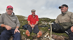 Feet First ....Brendan Caufield, Jimmy Connaugton and Michael Rattigan from Williamstown Co Galway taking a breather on their way to the summit of Croagh Patrick yesterday.