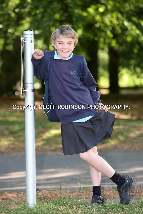 "PIC BY GEOFF ROBINSON PHOTOGRAPHY 07976 880732...EMBARGOED until 20:00 on Tuesday 22 November..FILE PIC DATED MAY 2011 SHOWS CHRIS WHITEHEAD AT SCHOOL IN IMPINGTON,CAMBRIDGE,WEARING A SKIRT AS A PROTEST TO NOT BEING ALLOWED TO WEAR SHORTS... A 13-year-old boy who wore a SKIRT to school in protest at a uniform ban on shorts has received a runner-up human right's prize...Chris Whitehead wore a short black girl's skirt for his classes at Impington Village College, Cambs, earlier this year because he believed its ""no shorts"" policy discriminated against boys...The Year 8 student, who borrowed the skirt from his younger sister Joanna, 11, said wearing long trousers in the heat affected boys' concentration levels and ability to study in class...The school later promised to review its decision...Now Chris, who is a member of the school's student executive, has become a runner-up in Liberty's human rights young person of the year competition for his two-day demonstration...""I didn't think it would be that influential, but I'm really happy, it was a good surprise to be nominated,"" he said...SEE COPY CATCHLINE Boy in skirt runner-up human rights prize"