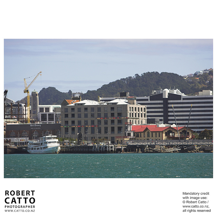The New Zealand Stock Exchange building and boatsheds seen from Lambton Harbour, Wellington, New Zealand.<br />