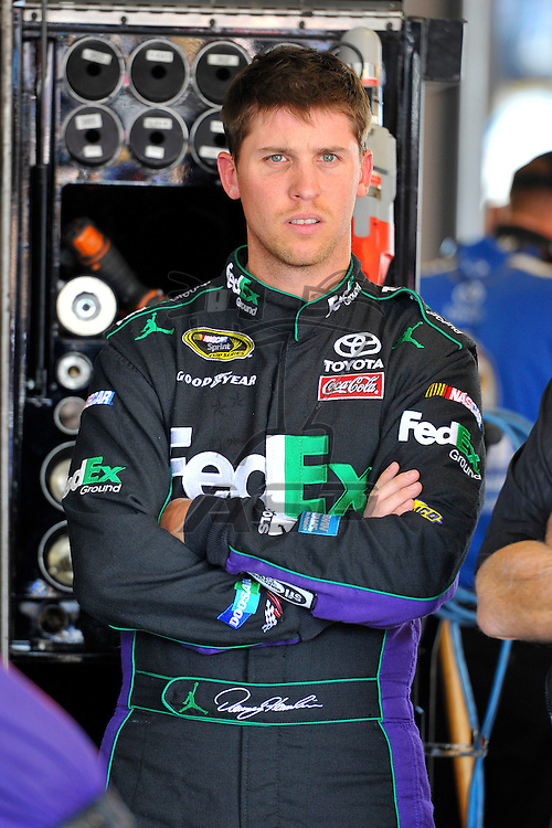 Joliet, IL - SEP 14, 2012: Denny Hamlin (11) stands in the garage during practice for the Geico 400 at the Chicagoland Speedway in Joliet, IL.