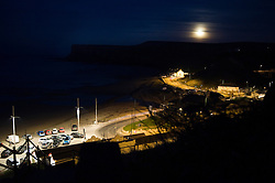 "© under license to London News Pictures. .Photos by Ian Forsyth. March 19, 2011..A full moon rises over Saltburn by the Sea in Cleveland. A moon that today will appear to be the biggest in almost 20 years. ..Called a ""perigee moon,""  this moon rise is a rare celestial event that occurs when the moon reaches the closest possible point of its orbit around the earth, about 212,000 miles away...Photo credit should read Ian Forsyth/LNP"
