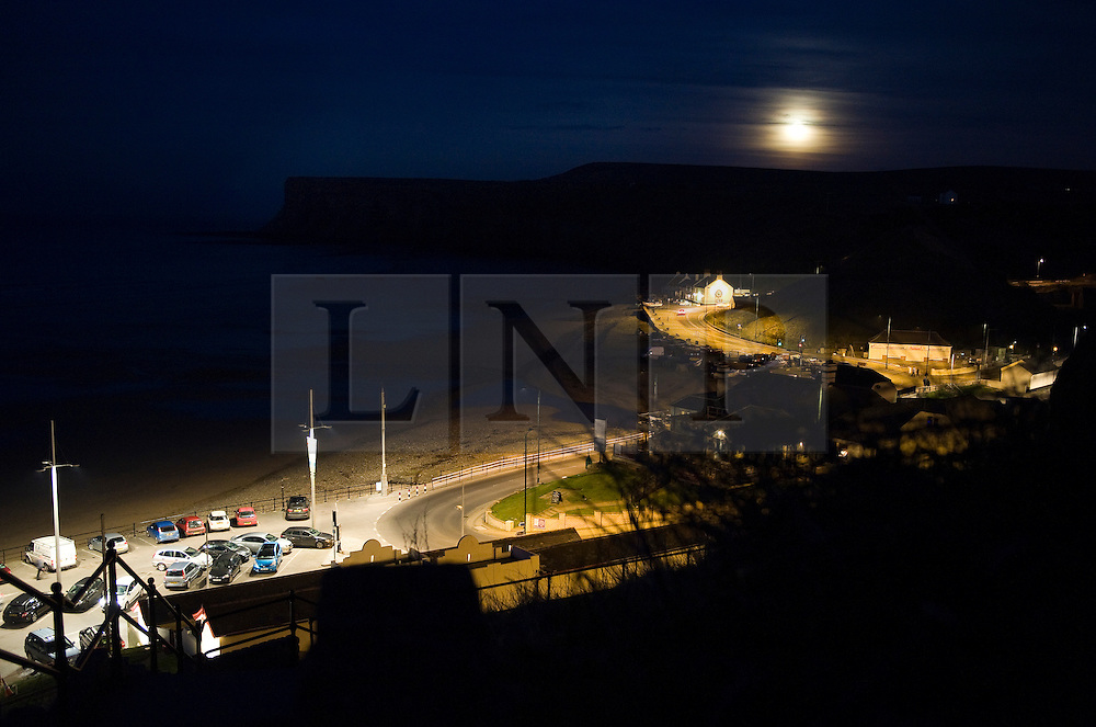 """© under license to London News Pictures. .Photos by Ian Forsyth. March 19, 2011..A full moon rises over Saltburn by the Sea in Cleveland. A moon that today will appear to be the biggest in almost 20 years. ..Called a """"perigee moon,""""  this moon rise is a rare celestial event that occurs when the moon reaches the closest possible point of its orbit around the earth, about 212,000 miles away...Photo credit should read Ian Forsyth/LNP"""