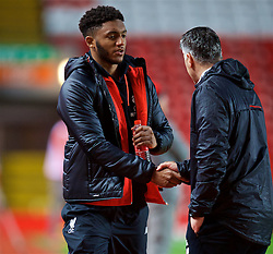 LIVERPOOL, ENGLAND - Monday, December 12, 2016: Liverpool's Joe Gomez shakes hands with coach Mike Garrity during FA Premier League 2 Division 1 Under-23 match against Arsenal at Anfield. (Pic by David Rawcliffe/Propaganda)