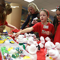 Lauren Wood | Buy at photos.djournal.com<br /> Fourth graders Carly Gransinger, center left, and Haylie Kirksey, right, look at different ornaments during the CLAUS Project Thursday afternoon at Lawndale Elementary School. Fourth grade students were raising money for Empty Table.
