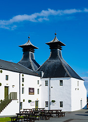 View of traditional malthouse pagodas at Ardbeg Distillery on island of Islay in Inner Hebrides of Scotland, UK