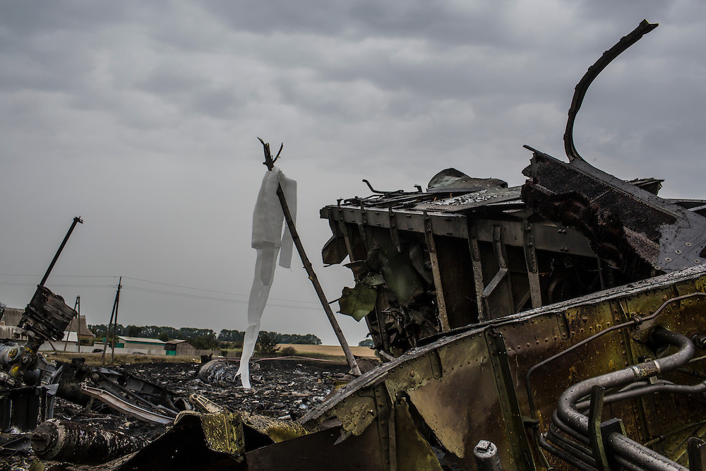 GRABOVO, UKRAINE - JULY 18: Debris from an Air Malaysia plane crash, including a white ribbon tied to a stick which indicates the presence of human remains, lies in a field on July 18, 2014 in Grabovo, Ukraine. Malaysia Airlines flight MH17 travelling from Amsterdam to Kuala Lumpur has crashed on the Ukraine/Russia border near the town of Shaktersk. The Boeing 777 was carrying 280 passengers and 15 crew members. (Photo by Brendan Hoffman/Getty Images) *** Local Caption ***