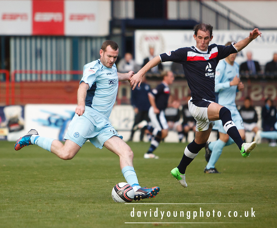 St Johnstone's Craig Beattie shoots while Dundee's Mark Kerr tries to block - Dundee v St Johnstone in the Clydesdale Bank Scottish Premier League at Dens Park.. - © David Young - 5 Foundry Place - Monifieth - DD5 4BB - Telephone 07765 252616 - email: davidyoungphoto@gmail.com - web: www.davidyoungphoto.co.uk