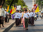 "04 APRIL 2015 - CHIANG MAI, CHIANG MAI, THAILAND: Tai (Shan) Burmese walk in a procession during the Poi Sang Long Festival in Chiang Mai. The Poi Sang Long Festival (also called Poy Sang Long) is an ordination ceremony for Tai (also and commonly called Shan, though they prefer Tai) boys in the Shan State of Myanmar (Burma) and in Shan communities in western Thailand. Most Tai boys go into the monastery as novice monks at some point between the ages of seven and fourteen. This year seven boys were ordained at the Poi Sang Long ceremony at Wat Pa Pao in Chiang Mai. Poy Song Long is Tai (Shan) for ""Festival of the Jewel (or Crystal) Sons.      PHOTO BY JACK KURTZ"