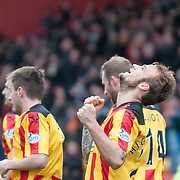 Partick Thistle's Kallum Higginbotham celebrates his winning goal in the Partick Thistle v Hibernian game in the Scottish Premiership at Firhill Stadium in Glasgow, 15 March 2014. (c) Paul J Roberts / Sportpix.org.uk
