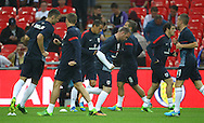 Picture by John Rainford/Focus Images Ltd +44 7506 538356<br /> 14/08/2013<br /> England's starting 11  warm up before the International Friendly match at Wembley Stadium, London.