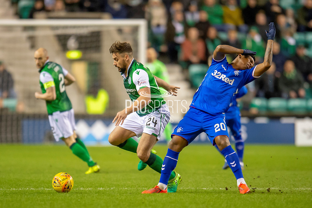 Darren McGregor (#24) of Hibernian FC uses an arm to hold off Alfredo Morelos (#20) of Rangers FC during the Ladbrokes Scottish Premiership match between Hibernian and Rangers at Easter Road, Edinburgh, Scotland on 8 March 2019.