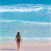 Woman enjoying the warm turquoise waters of Cancun. Quintana Roo. Mexico