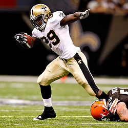 Oct 24, 2010; New Orleans, LA, USA; Cleveland Browns linebacker Matt Roth (53) grabs on to the ankle of New Orleans Saints running back Chris Ivory (29) during the first half at the Louisiana Superdome. Mandatory Credit: Derick E. Hingle