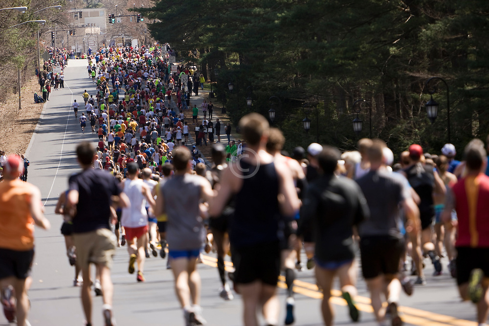 mass of runners fill the street near midpoint of race