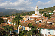 An aerial view of the terracotta roofs of Trinidad and the belltower of the<br /> Iglesia y Convento de San Francisco