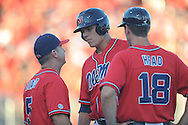Mississippi's  (5) talks with Mississippi's Colby Bortles (25) and Mississippi's Stephen Head in an NCAA Super Regional game in Lafayette, La. on Saturday, June 7, 2014.    Louisiana-Lafayette won 9-5.