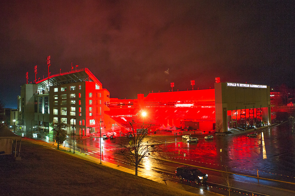 FAYETTEVILLE, AR - NOVEMBER 26:  Donald W. Reynolds Razorback Stadium lit up the night before with the red glow from the scoreboard before a game between the Arkansas Razorbacks and the Missouri Tigers at Razorback Stadium Stadium on November 26, 2015 in Fayetteville, Arkansas. The Razorbacks defeated the Tigers 28-3.   (Photo by Wesley Hitt/Getty Images) *** Local Caption ***