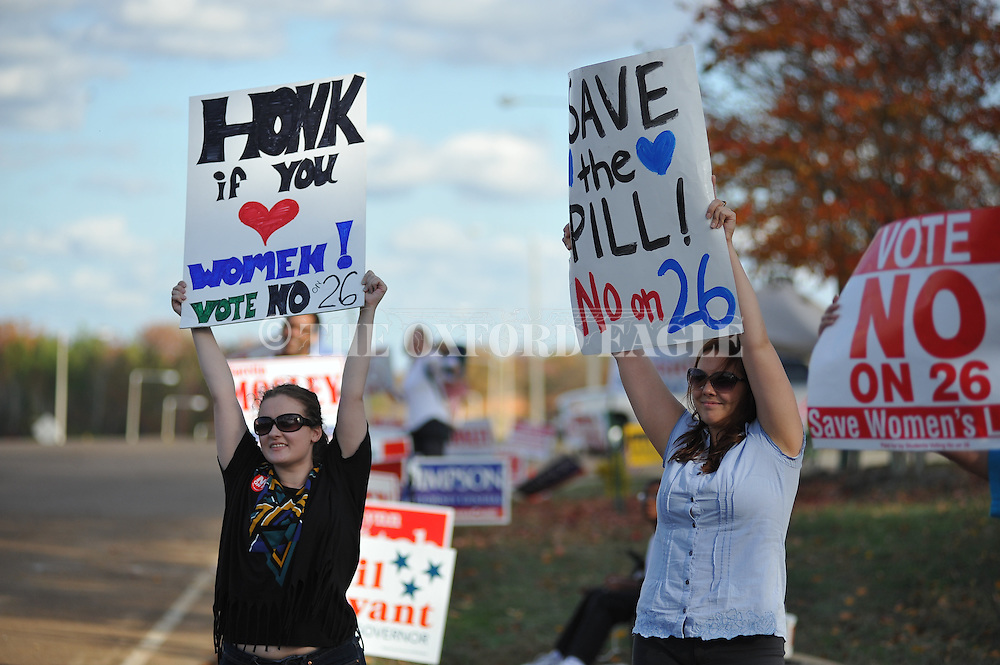 "Lindsey Clark (left) and Ashley Fly urge voters to vote ""NO"" on Amendment 26, the so-called Personhood Amendment, in Oxford, Miss. on Tuesday, November 8, 2011. Mississippians go to the polls today for state and local elections, as well as constitutional referendums."