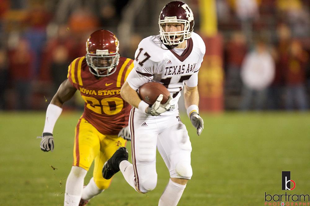Texas A&M quarterback Ryan Tannehill runs from Iowa State's Brandon Hunley at Iowa State on Saturday, Oct. 25, 2008.