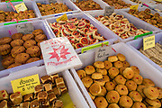 17 OCTOBER 2012 - BANGKOK, THAILAND: Vegan Chinese baked goods for sale at the Vegetarian Festival on Yaowarat Road in Chinatown in Bangkok. The Vegetarian Festival is celebrated throughout Thailand. It is the Thai version of the The Nine Emperor Gods Festival, a nine-day Taoist celebration celebrated in the 9th lunar month of the Chinese calendar. For nine days, those who are participating in the festival dress all in white and abstain from eating meat, poultry, seafood, and dairy products. Vendors and proprietors of restaurants indicate that vegetarian food is for sale at their establishments by putting a yellow flag out with Thai characters for meatless written on it in red.       PHOTO BY JACK KURTZ