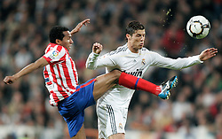 MADRID, SPAIN - Sunday, March 28, 2010: Real Madrid Club de Futbol's Christiano Ronaldo and Club Atletico de Madrid's Paulo Assuncao during the La Liga Primera Division Madrid Derby match at the Estadio Santiago Bernabeu. (Pic by Hoch Zwei/Sprimont Press/Propaganda)