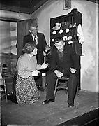 "28/04/1957<br /> 04/28/1957<br /> 28 April 1957<br /> Gael Linn- ""Muiris O hAirt"" drama at Damer Hall. In rehearsal (l-r) are: Aine Mic Giolla Bríde; Niall O'Dubhaigh and Prionnsias O'Maonaig."