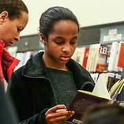 Lia Henderson (10) reads pages for Elena Delle Donne book while waiting in line to have her copy signed Saturday, March 10, 2018, at Barnes and Noble in Wilmington Delaware.