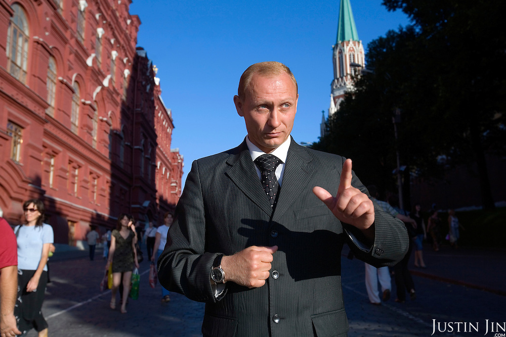 An actor mimmicking Russian President Vladimir Putin stands near the Red Square.