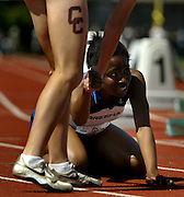 05/23/2009 - Gresham's Ify Onyima (408) is tapped after crossing the line during the 6A Girl's 400 Meter Dash. The 2009 OSAA/U.S. Bank/Les Schwab Tires 6A-5A-4A Track and Field State Championships were run at Hayward Field in Eugene, Oregon.....KEYWORDS:  City, Portland, sports, Oregon, high school, OSAA, boys, girls, PIL, run, University, team