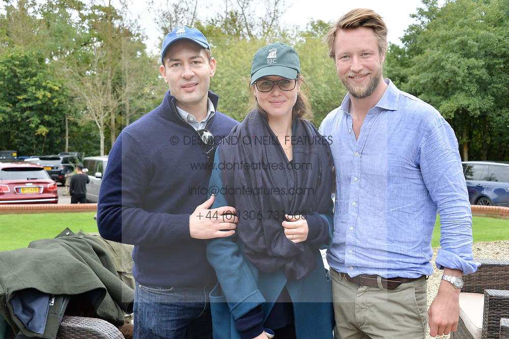 Left to right, Chris Afors, Juliana Aneli and Rob Wills at Young Guns raising money for the fight against breast cancer trough Cancer Research UK held at EJ Churchill Shooting School followed by lunch at West Wycombe Park, England. 23 September 2017.