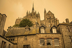A picture taken on October 16, 2017, in Mont Saint-Michel, Normandy, France, shows the sky after it turned a yellow-ochre colour due to sand from the Sahara desert and dust from wildfires in Portugal being carried by wind from the Storm Ophelia. Photo by Vincen M/ANDBZ/ABACAPRESS.COM