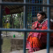 KOLKATA, WEST BENGAL - 14 DECEMBER, 2016: Kanon Sarkar, 26, holds her baby's blanket at her home near Machlampur, outside Kolkata, West Bengal, India.<br />