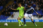 Brighton midfielder Steve Sidwell (36) and Birmingham City Carl Lafferty (25) during the Sky Bet Championship match between Birmingham City and Brighton and Hove Albion at St Andrews, Birmingham, England on 5 April 2016.