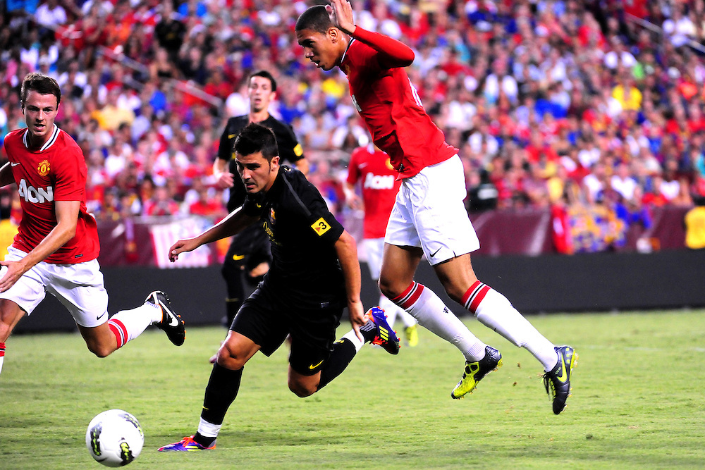 Chris Smalling (Manchester United) takes on David Villa (FC Barcelona). - FC Barcelona vs. Manchester United - Pre-Season Friendly at Red Bull Arena, New York - 30/07/11 - Mandatory Credit: Pixel8 Photos/Jack Megaw - +44(0)7734 151429 - info@pixel8photos.com - NO UNPAID USE.